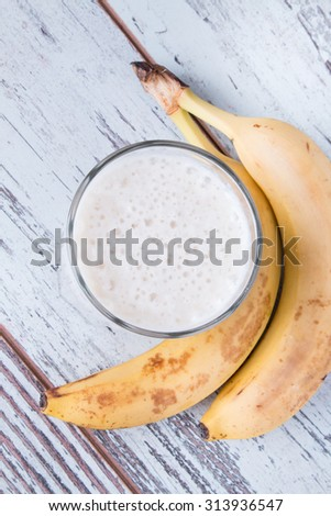 Fresh milk,  banana drink on wodeen table, assorted protein cocktail with fresh fruits.  - stock photo