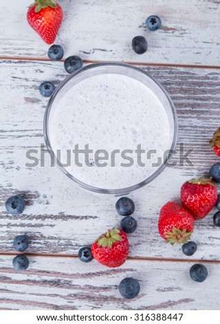 Fresh milk, blueberry drink on wooden table, assorted protein cocktail with fresh fruits. - stock photo