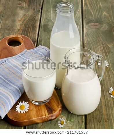 Fresh milk on a wooden table. Selective focus - stock photo