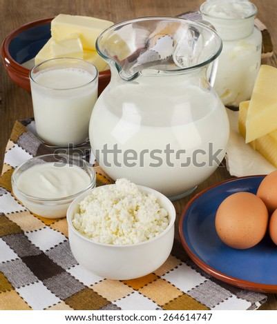 Fresh Milk products on   wooden background. Selective focus - stock photo