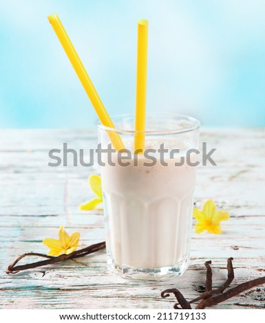 Fresh milk, raspberry, blueberry and vanilla drinks on wooden table, assorted protein cocktails with fresh fruits and nature background. Healthy lifestyle. - stock photo