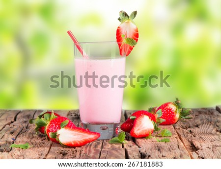 Fresh milk, strawberry drink on wooden table, assorted protein cocktails with fresh fruits.  - stock photo
