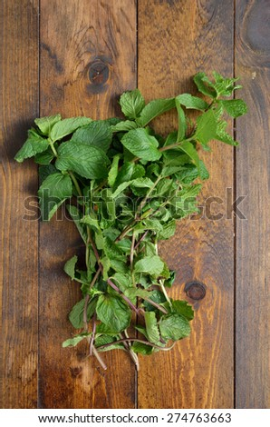 Fresh mint leaves on a wooden table           - stock photo