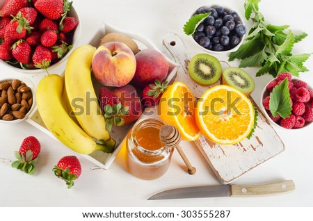 Fresh mixed fruits and berries. Healthy food. Top view - stock photo