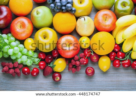 Fresh mixed fruits on wooden board, concept of healthy eating and diet - stock photo