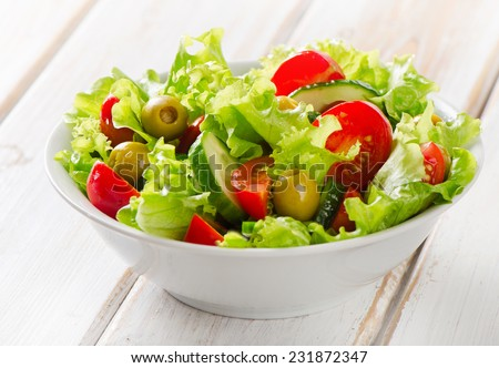 Fresh mixed vegetables salad. Selective focus - stock photo