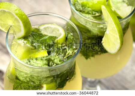 Fresh mojito cocktail in glass tumblers - stock photo