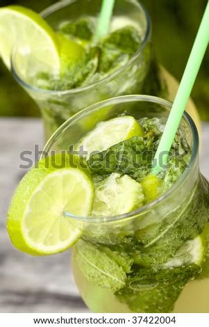 Fresh mojito cocktail in glass tumblers - stock photo
