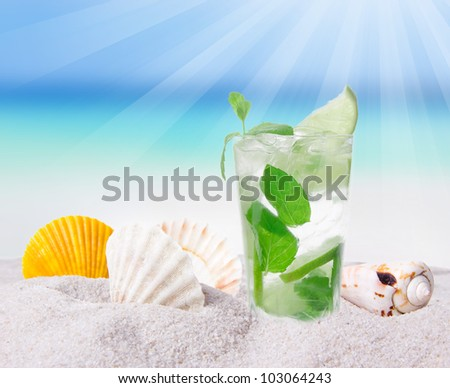 Fresh mojito drink on the beach - stock photo
