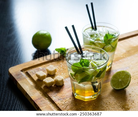 Fresh mojito drink on the wooden table - stock photo