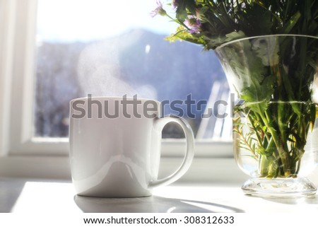 Fresh morning coffee, morning sun coming through the window. - stock photo