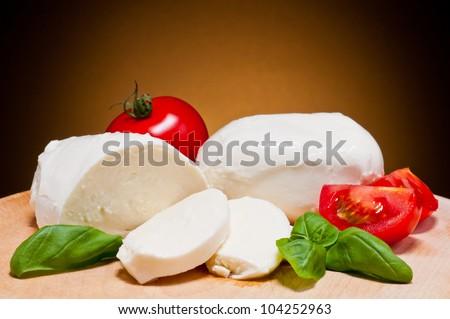 fresh mozzarella, tomatoes and basil - stock photo