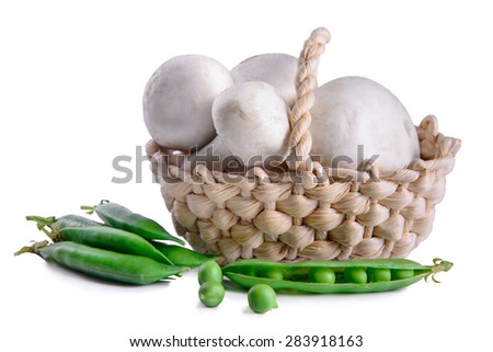 fresh mushrooms and green peas in a basket. Isolated on white - stock photo
