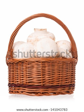 Fresh mushrooms in a wicker basket isolated on a white background - stock photo