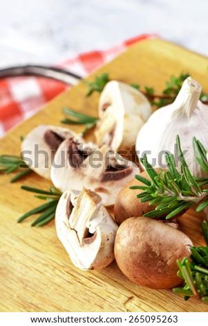 Fresh mushrooms on wooden backgroun - stock photo