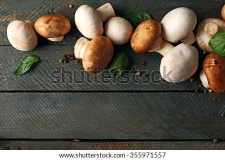 Fresh mushrooms on wooden background - stock photo