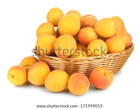 Fresh natural apricot in wicker basket isolated on white - stock photo
