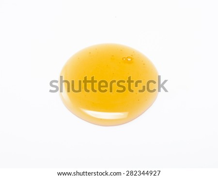fresh natural honey drop isolated on white background - stock photo