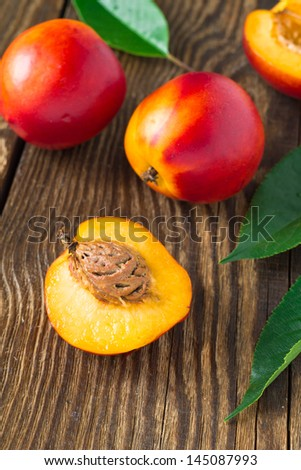 Fresh nectarines on a dark wooden background - stock photo