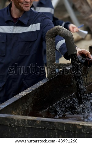 Fresh oil flow from pipe. - stock photo