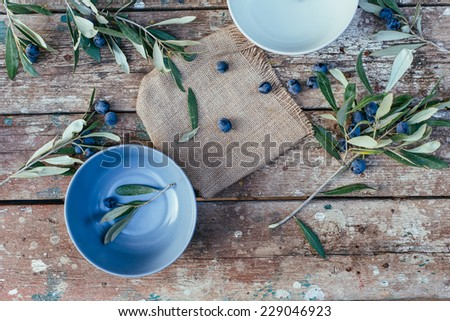 fresh Olives on a wooden table - stock photo