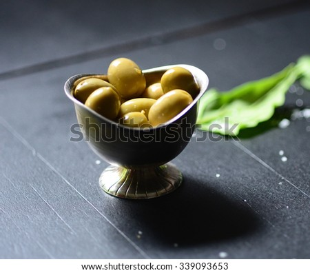 Fresh olives on wooden table - stock photo