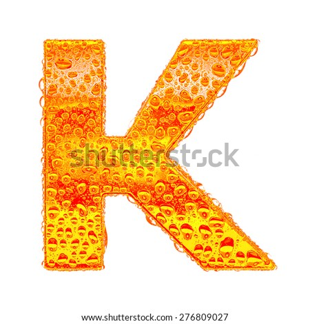 Fresh Orange alphabet symbol - letter K. Water splashes and drops on transparent glass - color of brandy , cognac, liquor, cola, beer or tea. Isolated on white - stock photo