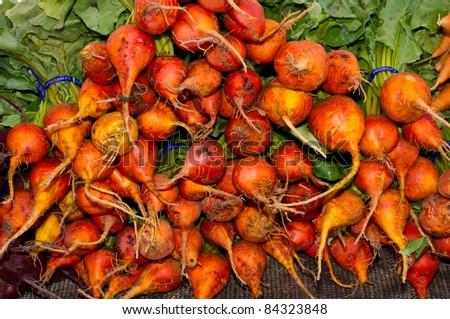 Fresh orange beets on display at the farmer's market - stock photo