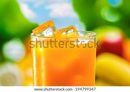 Fresh orange juice, cold drink with ice - stock photo