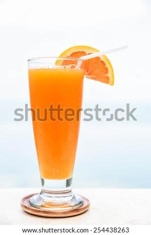 Fresh orange juice with background - stock photo