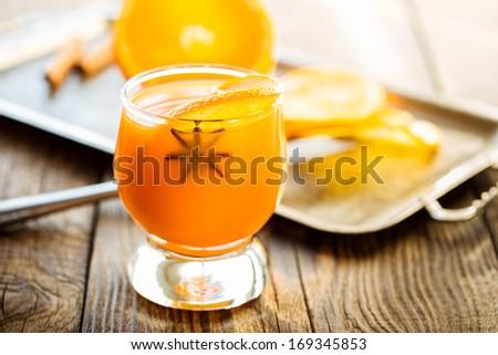 Fresh orange juice with orange slice and anise for winter and Christmas - stock photo