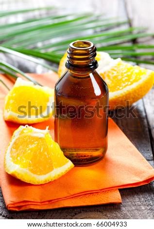 fresh orange oil in a bottle - stock photo