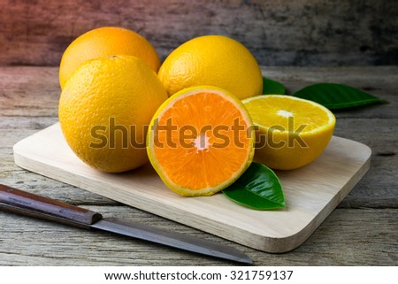Fresh Orange on a cutting board and knife. Selective focus. - stock photo