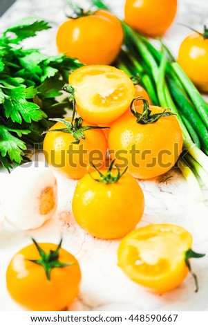 fresh orange tomato, juicy summer vegetables and juicy greens, healthy lifestyle and food concept,selective focus - stock photo