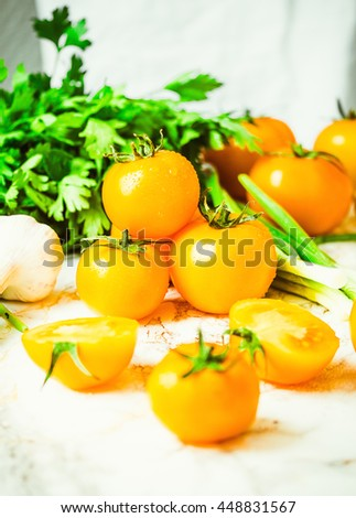 fresh orange tomatoes, juicy summer vegetables and juicy greens, healthy lifestyle and food concept - stock photo