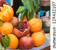 Fresh oranges and pomegranates for juice at market in Turkey - stock photo