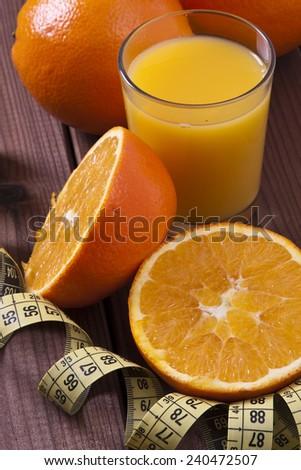 fresh oranges and tape - stock photo