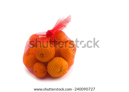 fresh Oranges Fruits In Mesh From Supermarket - stock photo