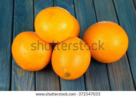 Fresh oranges on a blue wooden table - stock photo