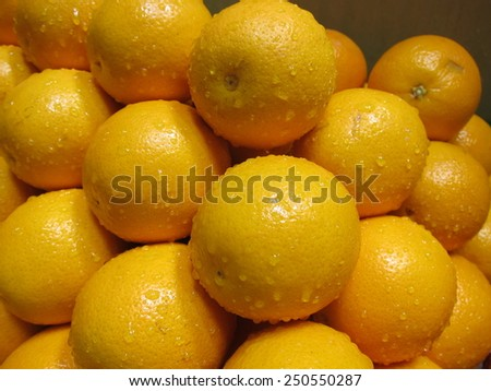 Fresh oranges selling at the market stall - stock photo