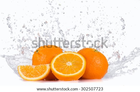 Fresh oranges with water splashes. - stock photo