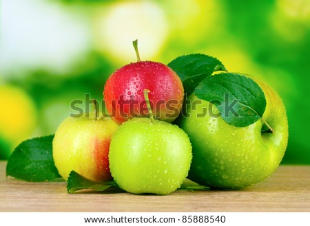 Fresh organic apples on wooden table isolated on white - stock photo