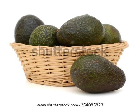 fresh organic avocados in basket - stock photo