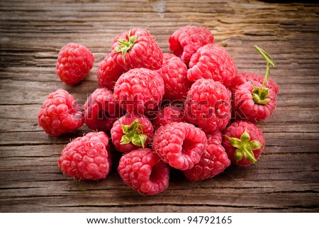 Fresh organic fruit - raspberry on wood background selective focus - stock photo