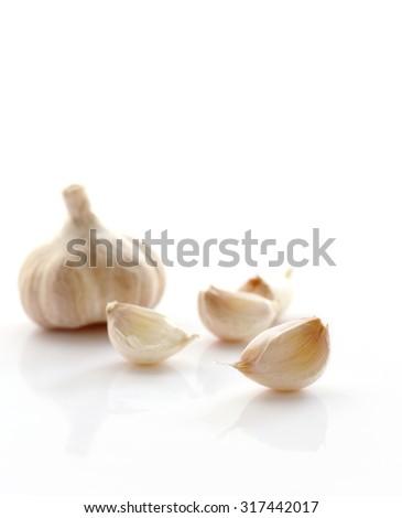 Fresh organic garlic on white background, selective focus. - stock photo