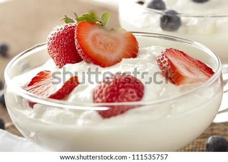 Fresh Organic Greek Yogurt with strawberries on a background - stock photo