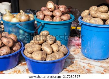 Fresh organic potatoes to sale at the farmers market - stock photo