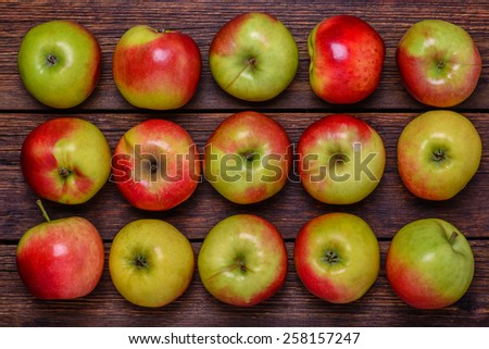 Fresh organic red apples on wooden table close-up - stock photo