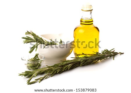 Fresh organic rosemary  and olive oil isolated on white background - stock photo