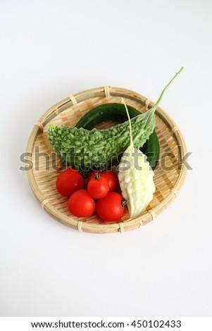 Fresh Organic Summer Vegetable in JAPAN (bitter gourd,tomato,cucumber) - stock photo